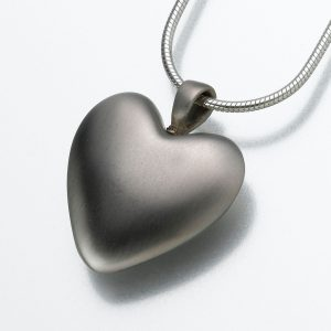 A silver heart pendant. An example of cremation jewelry provided by Simply Cremations.