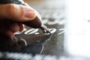 An engraver etches the dates into a black headstone. Can you have a headstone if you are cremated?