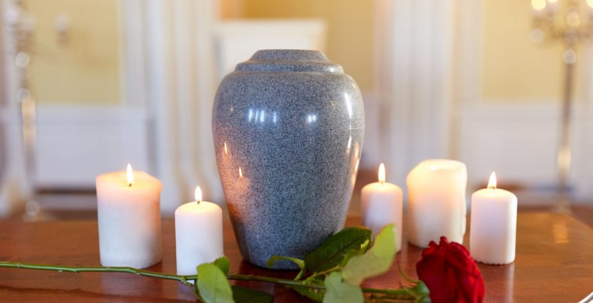 Memorial service or funeral? An urn and a few candles is an example of a memorial service provided by Simply Cremation & Funeral Care..