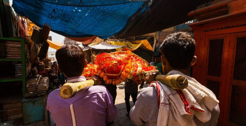 Religious Beliefs About cremation may differ wildly, like this Hindu cremation procession, which is more accepted than other religions.
