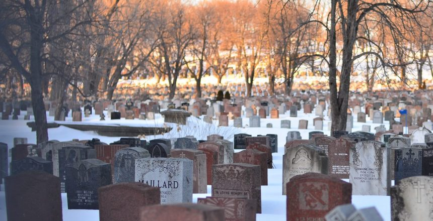 A snow covered cemetery. Cremation is becoming more popular than traditional burials in the cremation vs burial debate.