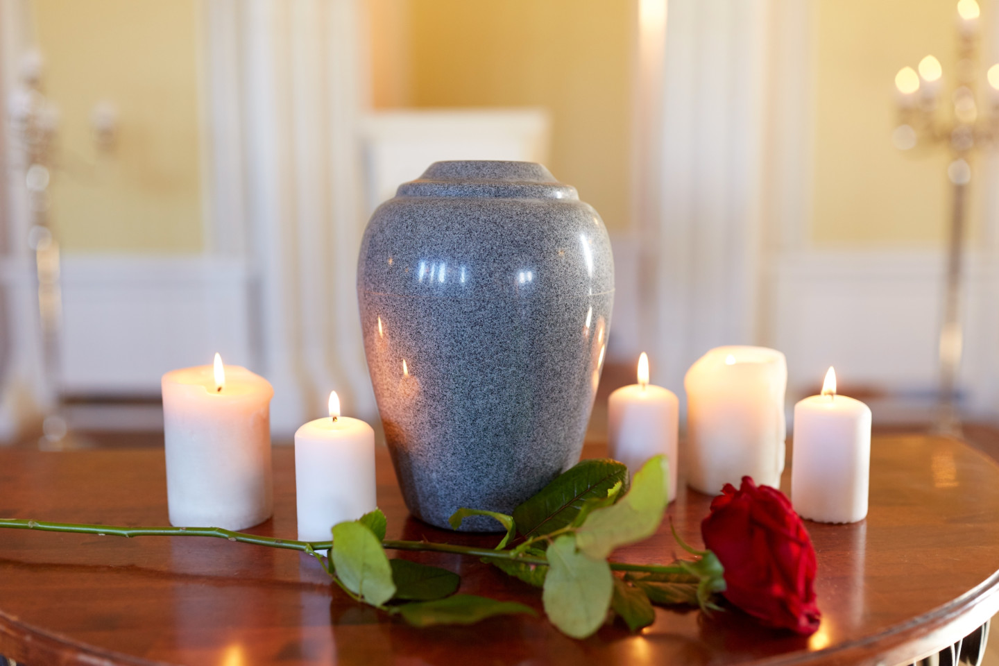 An urn and a few candles is an example of the type of cremation services available to you by Simply Cremations.